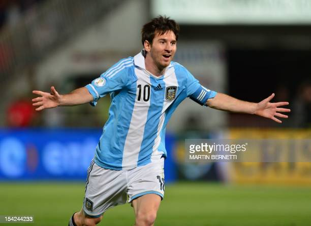 Argentine forward Lionel Messi celebrates after scooring against Chile, during their Brazil 2014 FIFA World Cup South American qualifier, at the...