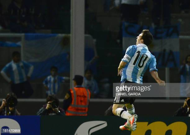 Argentine forward Lionel Messi celebrates after scoring against Paraguay during a Brazil 2014 World Cup South American qualifier match at Mario...