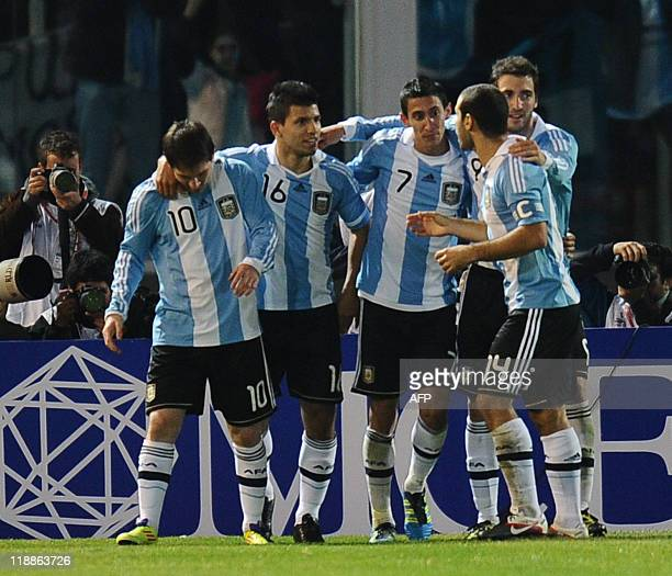 Argentine forward Lionel Messi forward Sergio Aguero midfielder Angel di Maria forward Gonzalo Higuain and midfielder Javier Mascherano celebrate...