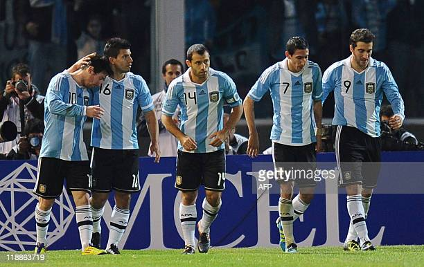 Argentine forward Lionel Messi forward Sergio Aguero midfielder Javier Mascherano midfielder Angel di Maria and forward Gonzalo Higuain celebrate...