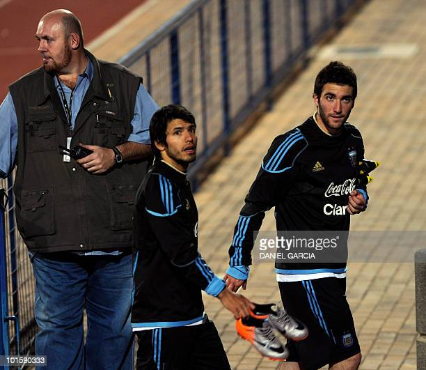 Argentine forwards Sergio Aguero and Gonzalo Higuain leave the field after a training session at the University of Pretoria on June 3 2010 The FIFA...