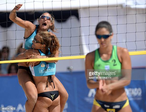 Argentine Georgina Klug celebrates the victory over Brazil with teammate Ana Gallay during the South American beach volleyball tournament final match...