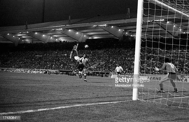 Argentine goalkeeper Daniel Carnevali watching Italian forward Sandro Mazzola kicking in the match between Italy and Argentina at the World Cup...