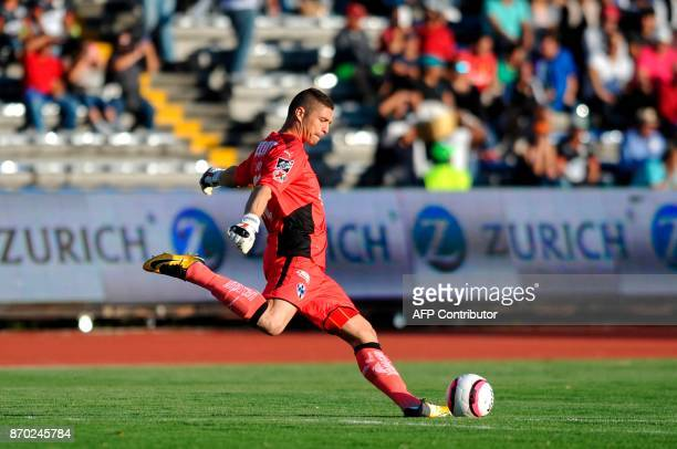 Argentine goalkeeper Juan Carrizo of Monterrey kicks the ball during the match against Lobos Buap for the 2017 Mexican Apertura Tournament at...