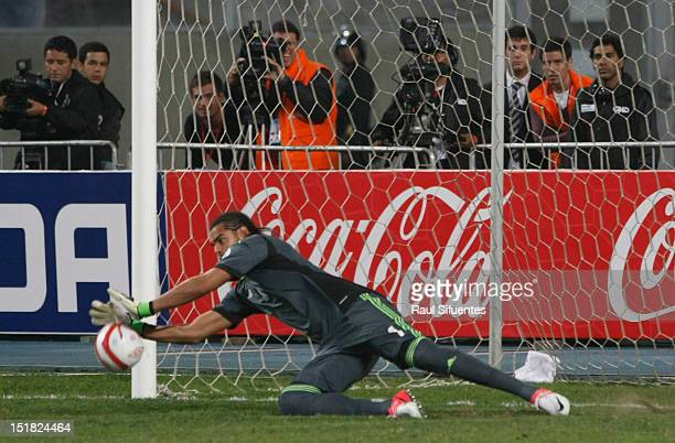 Argentine goalkeeper Sergio Romro stops a penalty kick of Peruvian Claudio Pizarro during a match between Peru and Argentina as part of the South...