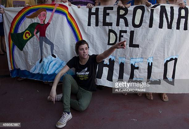 Argentine Greenpeace activist Camila Speziale poses in front of a banner reading 'Heroine of the Ice' after arriving at Ezeiza International Airport...