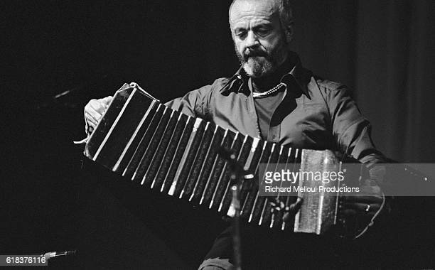 Argentine jazz and tango musician Astor Piazzola plays the bandoneon during a performance at the Olympia in Paris