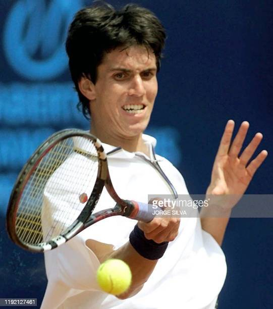 Argentine Juan Ignacio Chela returns the ball during a match against compatriot Mariana Puerta in the Mexican Tennis Open 27 February 2000 Chela won...