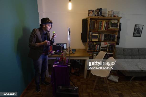 Argentine magician Gustavo Pintos, known as 'Mago Kaphu', performs from his home on June 5 during a birthday party celebrated virtually in La Rioja...