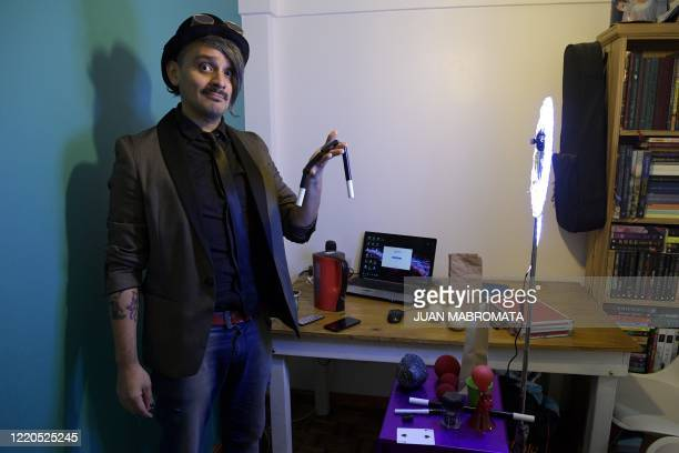 Argentine magician Gustavo Pintos, known as 'Mago Kaphu', poses at his home on June 5 before performing in a birthday party celebrated virtually in...