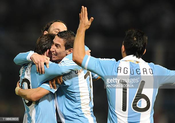 Argentine midfielder Angel di Maria celebrates with teammates Lionel Mess i Gabriel Milito and Sergio Aguero after scoring his team´s third goal...