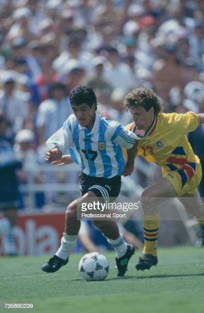 Argentine midfielder Ariel Ortega and Romanian player Tibor Selymes clash as they battle for the ball in the 1994 FIFA World Cup knockout stage round...