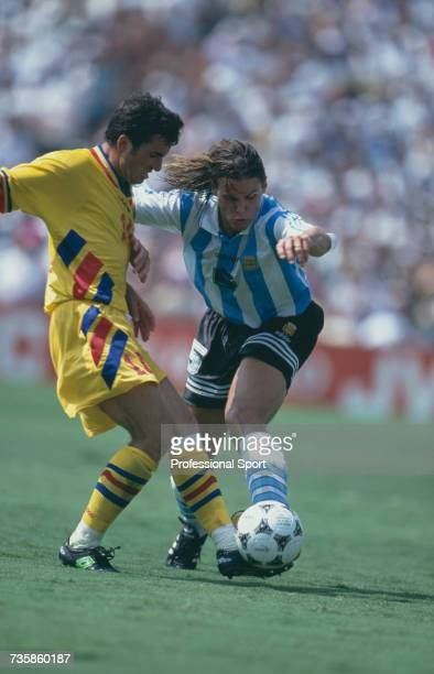 Argentine midfielder Fernando Redondo clashes with Romanian captain Gheorghe Hagi for the ball in the 1994 FIFA World Cup knockout stage round of 16...