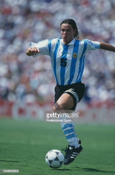 Argentine midfielder Fernando Redondo pictured in action making a run with the ball in the 1994 FIFA World Cup knockout stage round of 16 match...