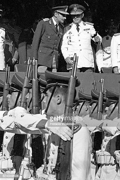 Argentine military dictator Jorge Rafael Videla chats with Paraguayan dictator Alfredo Stroessner during a military parade in Asuncion It was under...