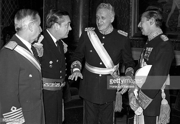 Argentine military dictators Leopoldo Fortunato Galtieri and Jorge Rafael Videla chat with members of the second military junta, Omar Graffigna,...