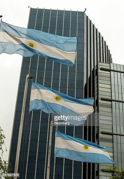 Argentine national flags wave in front of the headquarters of Telecom Personal SA a subsidiary of Telecom Italia SpA in Buenos Aires Argentina on...