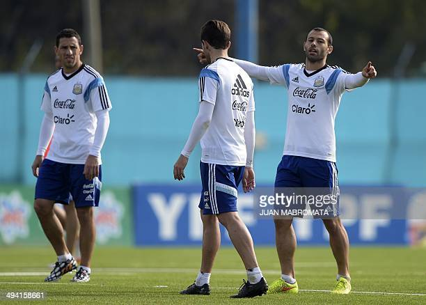 Argentine national football team midfielders Javier Mascherano Maximiliano Rodriguez and Fernando Gago are pictured during a training session at the...