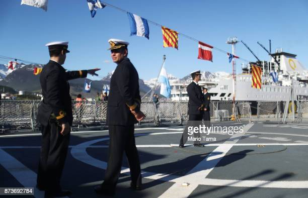 Argentine Navy sailors stand aboard a destroyer docked for visitor tours on November 5 2017 in Ushuaia Argentina Ushuaia is situated along the...