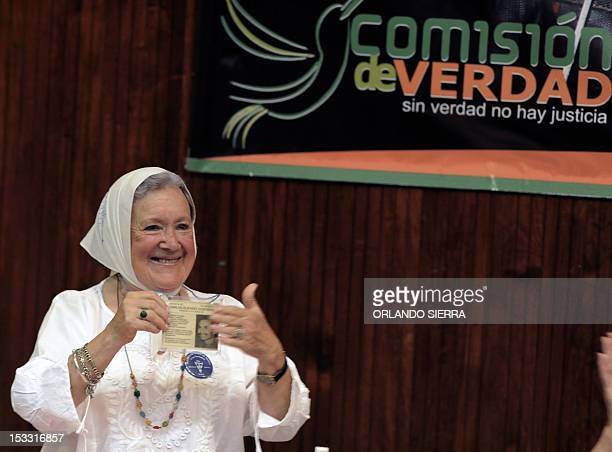 Argentine Nora Cortina member of the Mothers of Plaza de Mayo human rights organization shows a picture of her son Carlos Gustavo detained and...