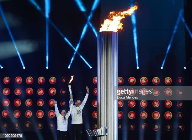 Argentine olympians and gold medalists Paula Pareto and Santiago Lange light the the Olympic Cauldron during the opening ceremony of the Buenos Aires...