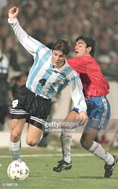Argentine player Javier Zanetti battles Chilean player Esteban Valencia for the ball 11 July during their Group C Copa America match at the Artigas...