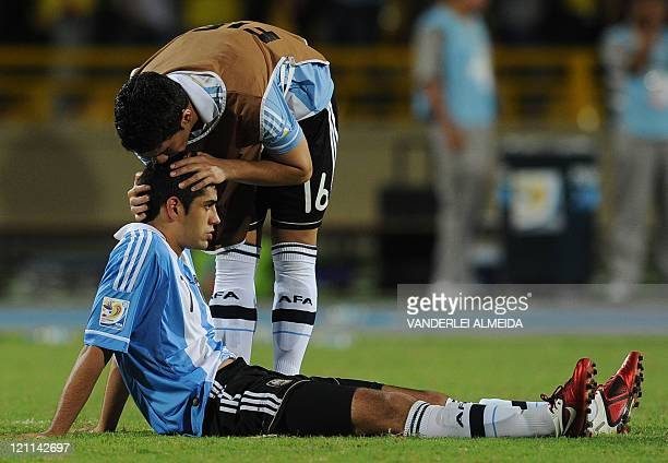 Argentine player Lucas Villafanez comforts teammate Matias Laba after their FIFA World Cup U20 football match against Portugal at Jaime Moron Olimpic...