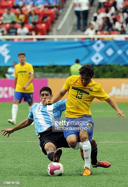 Argentine player Matias Laba vies for the ball with Rafael De Souza of Brazil in their preliminary football match for the XVI Pan American Games in...