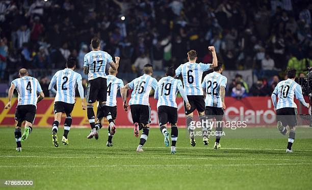 Argentine players celebrate after beating Colombia during the 2015 Copa America football championship quarterfinal match in Vina del Mar Chile on...