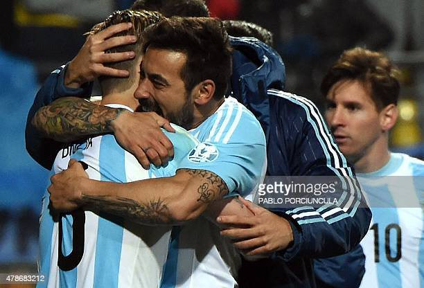 Argentine players celebrate after beating Colombia in their 2015 Copa America football championship quarterfinal match in Vina del Mar Chile on June...