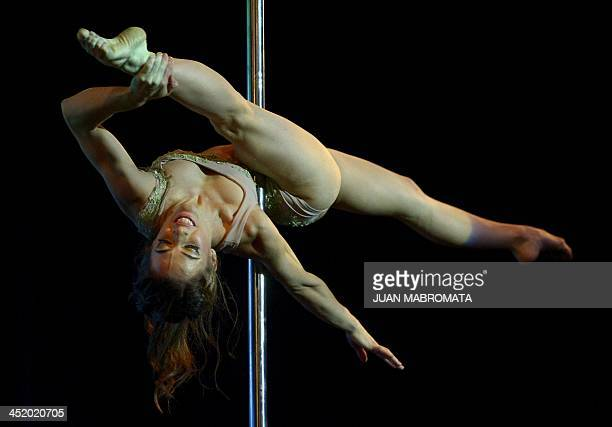 Argentine pole dancer Maria Aguiar competes in the South America and Argentina 2013 Pole Dance competitions in Buenos Aires on November 25 2013 AFP...