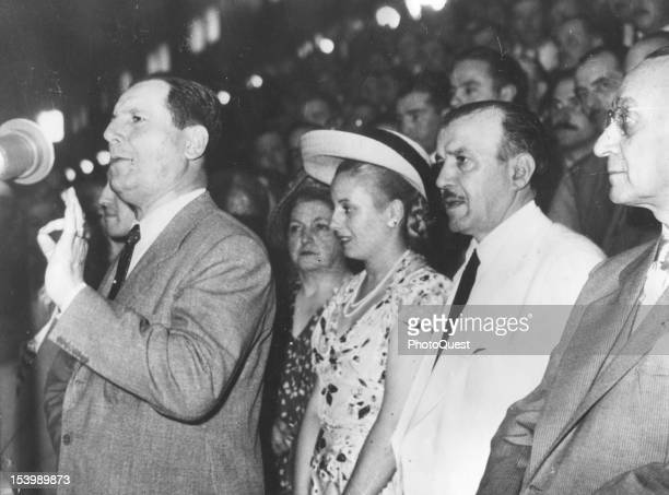Argentine politician and President of Argentina Juan Peron addresses an indoor assembly Buenos Aires Argentina 1947 First Lady and Spiritual Leader...