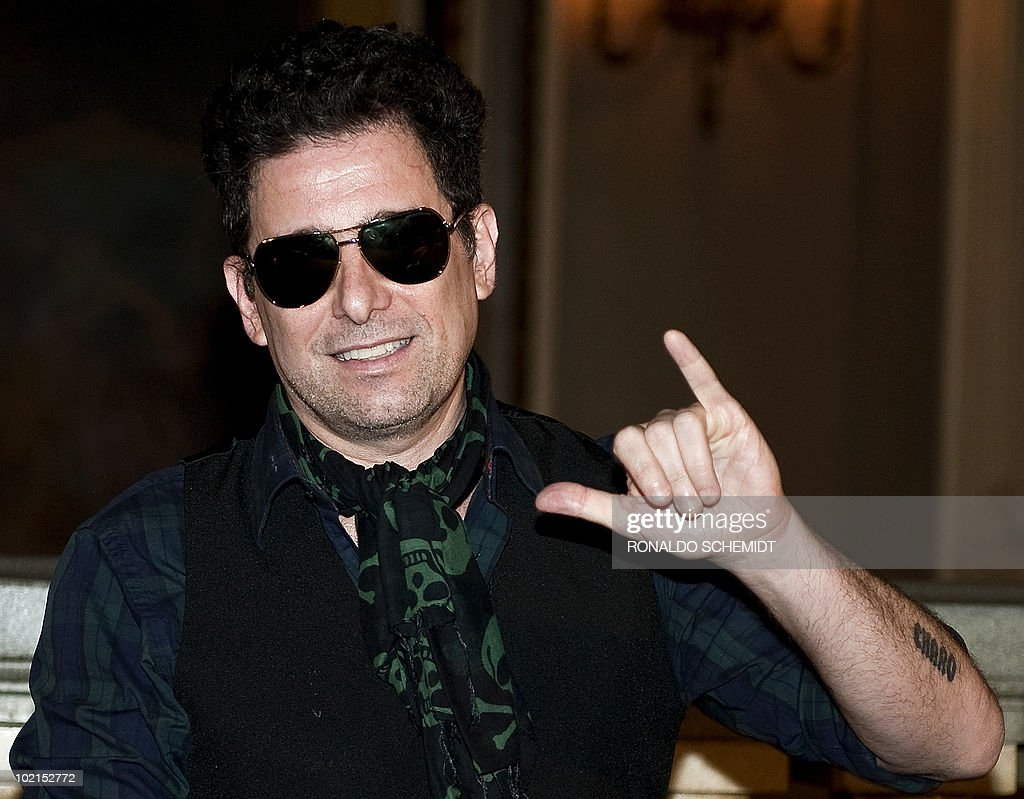 Argentine pop singer Andres Calamaro listens to a question during a press conference to present his new album 'On The Rock' in Mexico City, on June 16, 2010. AFP PHOTO/Ronaldo SCHEMIDT