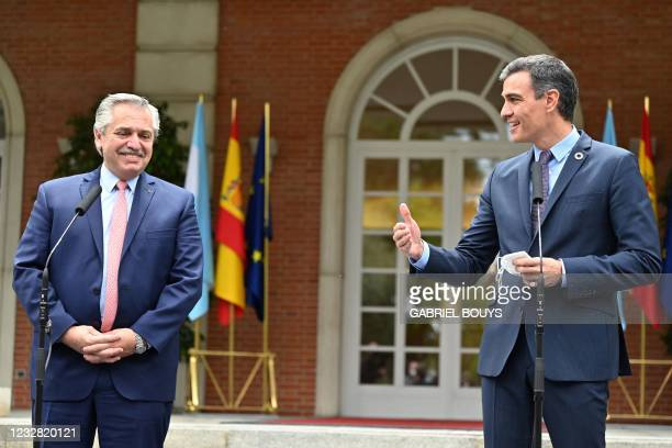 Argentine President Alberto Fernandez talks to the press outside the Moncloa Palace in Madrid on May 11, 2021.