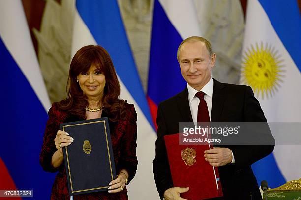 Argentine President Cristina Fernandez de Kirchner and Russian President Vladimir Putin poseafter signing bilateral agreements at the Kremlin in...