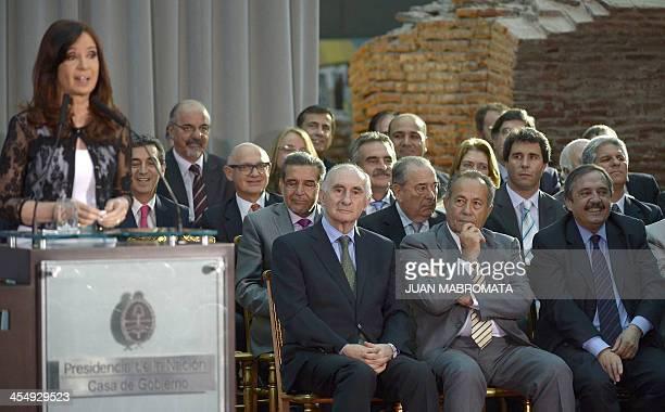 Argentine President Cristina Fernandez de Kirchner delivers a speech alongside former Presidents Fernando de La Rua and Adolfo Rodriguez Saa and...