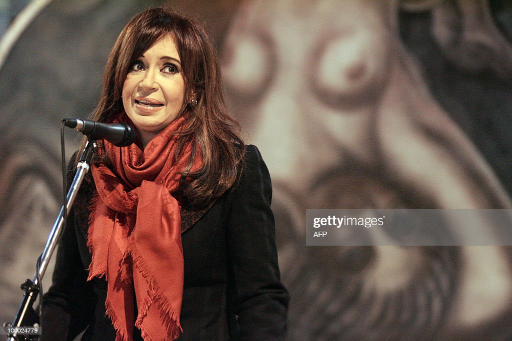 Argentine President Cristina Kirchner speaks May 20, 2010 in front of a part of the mural painting 'Ejercicio Plastico' made in 1933 in Argentina by Mexican artist David Siqueiros and local painters on the roof, four walls and the floor of a vault underground mansion in the northern outskirts of Buenos Aires. The work is being reinstalled at the basement of the old Customs House of Buenos Aires and will be opened to the public as part of the celebrations for the Independence Bicentennial.