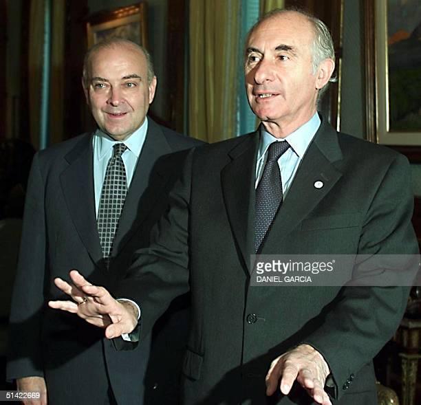 Argentine President Fernando de la Rua and Argentine Economy Minister Domingo Cavallo prepare to receive a delegation from French automaker Peugeot...