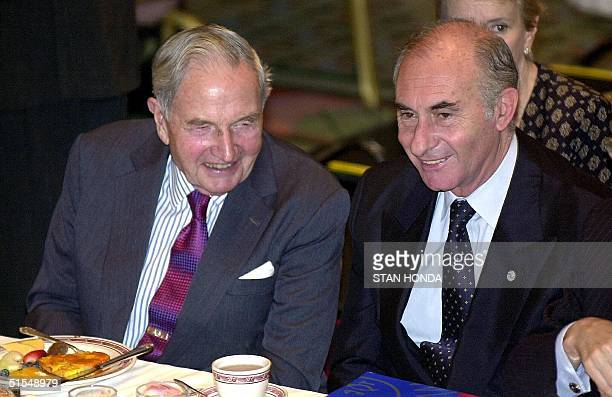 Argentine President Fernando de la Rua sits next to US business man David Rockefeller at a meeting of the Americas Society 12 June at the...