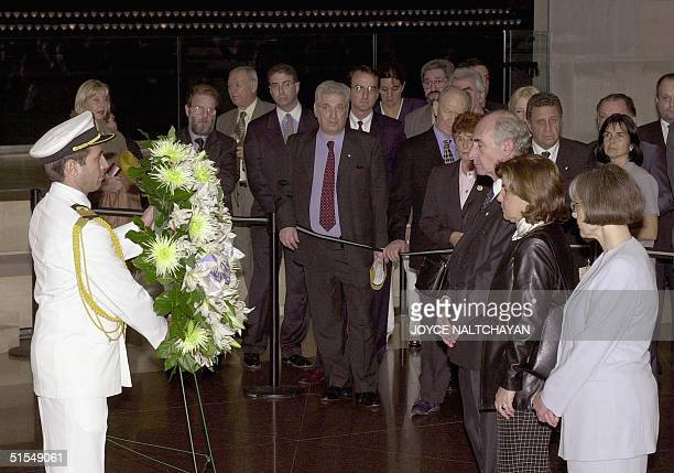 Argentine President Fernando de la Rua stands with his wife Maria Ines Pertine during a wreath laying ceremony 13 June in the Hall of Remembrance at...