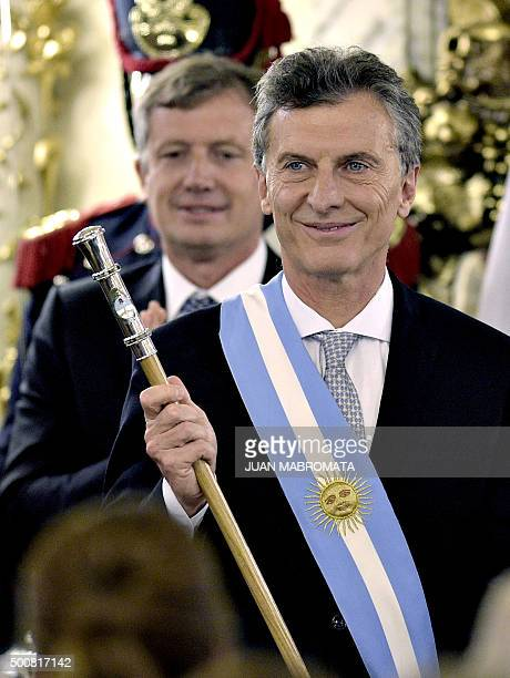 Argentine President Mauricio Macri already wearing the presidential sash and staff poses during his inauguration at the Casa Rosada government palace...