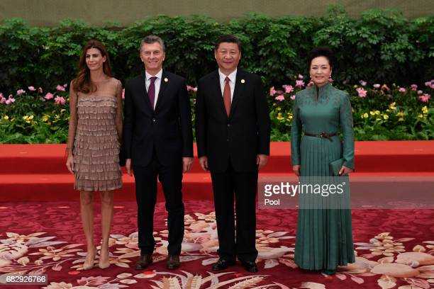 Argentine President Mauricio Macri and his wife Juliana Awada pose with Chinese President Xi Jinping and his wife Peng Liyuan during a welcome...