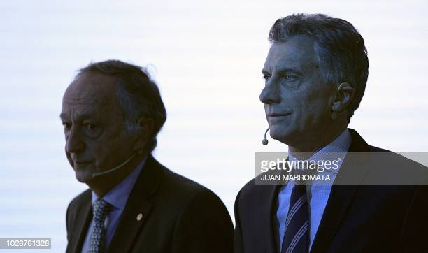 Argentine President Mauricio Macri and the president of the Argentine Industrial Union Miguel Acevedo attend the closing ceremony of UIA's 24th...