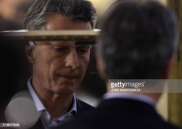 Argentine President Mauricio Macri is reflected in a mirror after delivering a speech at Casa Rosada Government Palace in Buenos Aires on April 7...
