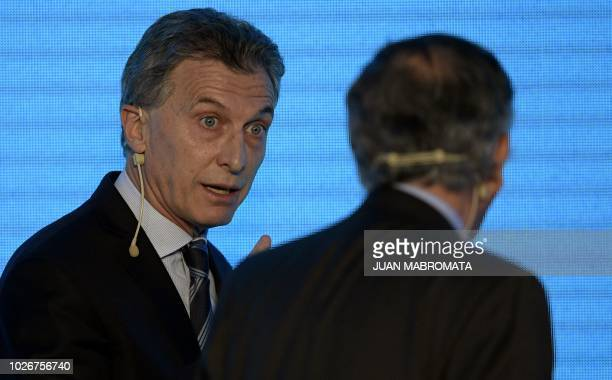 Argentine President Mauricio Macri speaks with the president of Argentine Industrial Union Miguel Acevedo during the closing ceremony of the UIA's...