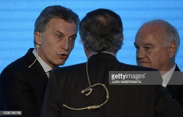 Argentine President Mauricio Macri speaks with the president of Argentine Industrial Union Miguel Acevedo and UIA's secretary Alberto Alvarez...