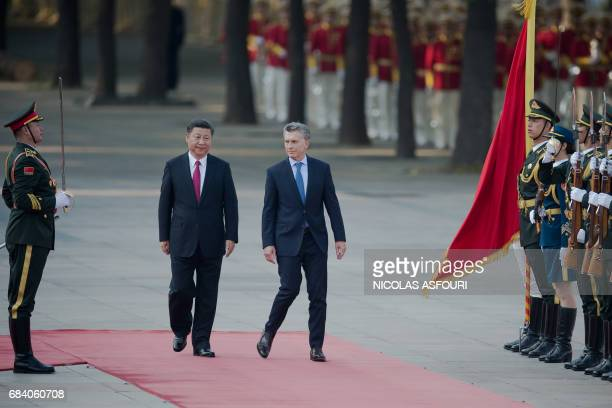 Argentine President Mauricio Macri walks with Chinese President Xi Jinping during a welcome ceremony outside the Great Hall of the People in Beijing...