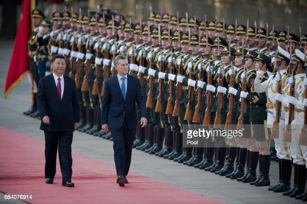 Argentine President Mauricio Macri walks with Chinese President Xi Jinping during a welcome ceremony outside the Great Hall of the People on May 17,...