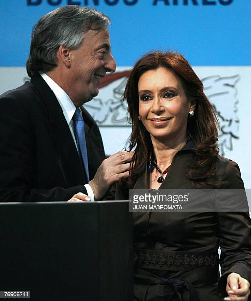 Argentine president Nestor Kirchner allows his wife senator and presidential candidate Cristina Fernandez to deliver a speech during an official...
