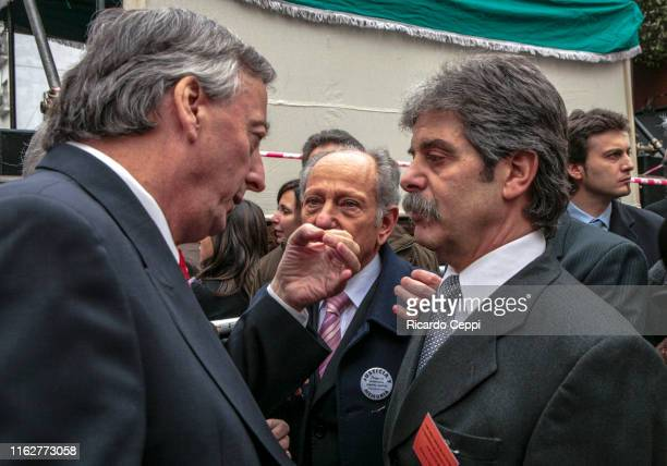 Argentine President Nestor Kirchner speaks with the leader of Relatives and Friends of the Victims of AMIA Sergio Burstein during a commemoration...